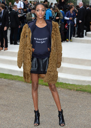 Jourdan Dunn completed her look with black open-toe ankle boots, also by Burberry.