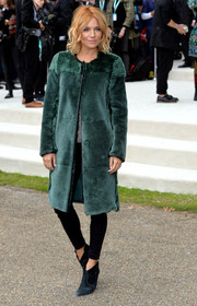 Sienna Miller looked luxuriously cool in a teal fur coat by Burberry Prorsum during the brand's fashion show.