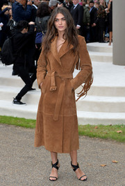 Elisa Sednaoui was chicly bundled up in a fringed suede coat during the Burberry Prorsum fashion show.