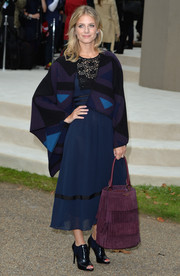Melanie Laurent looked demure in a blue Burberry cocktail dress with black lace trim during the label's fashion show.