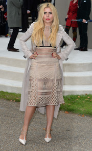 Paloma Faith teamed a nude lattice-panel dress by Burberry with a matching trenchcoat for the label's fashion show.