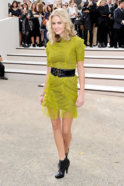 Donna cinched her lime green ruched dress with a leather double buckle belt.