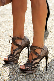 In true SJP fashion, Sarah added some flair to her look with lizard and mesh lace up sandals.