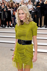 Donna Air paired her lime green ruched dress with a patent leather double buckle belt.