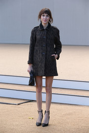 Alexa Chung paired black ankle-strap pumps with a printed coat for a simple yet stylish finish at the Burberry Prorsum fashion show.