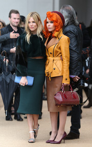 Paloma Faith teamed a studded red bowler bag with a trenchcoat and a pencil skirt, all by Burberry, for an ultra-stylish finish during the brand's fashion show.