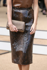 Donna Air absolutely stole the limelight in this fabulous brown python pencil skirt during the Burberry Prorsum fashion show.