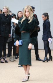 Sienna Miller looked trendy and luxe at the Burberry Prorsum fashion show in a textured teal pencil skirt and a fur crop-top.