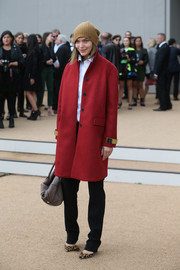 Arizona Muse was stylish in a red wool coat layered over a white button-down and black pants at the Burberry Prorsum fashion show.