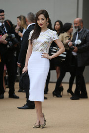Patty Hou looked darling in a little white dress with a studded bodice during the Burberry Prorsum fashion show.
