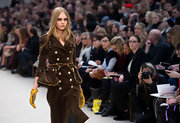Cara Delevingne wore a double-breasted velvet trenchcoat at the runway show for Burberry Prorsum.