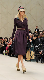 Cara Delevingne marched the runway wearing a pair of woven-heeled peep-toes at the Burberry SS2012 show.