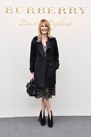 Laura Dern kept it classic in a black Burberry trenchcoat layered over a print dress during the label's fashion show.