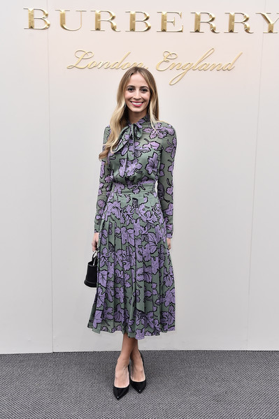 Harley Viera-Newton was prim and proper in a long-sleeve, tie-neck print dress by Burberry during the label's fashion show.