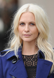 Poppy Delevingne attended the Burberry Prorsum fashion show sporting messy-chic platinum blonde waves.