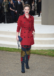 Holliday Grainger arrived for the Burberry Prorsum fashion show looking super chic in a red trenchcoat from the brand.