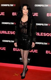 Cher opted for all-black separates, consisting of a sequined mini skirt, a sheer blouse, and a fur-lapel jacket, when she attended the 'Burlesque' premiere in Madrid.