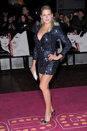 Abi Titmuss paired a sparkling French Connection frock with silver Christian Louboutin heels. The bow-adorned t-strap pumps were a playful red carpet choice.