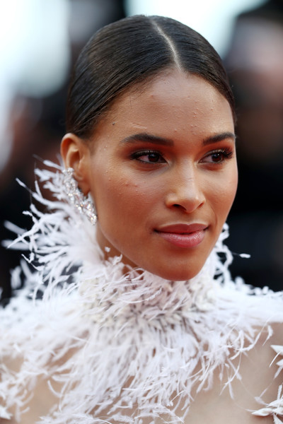 Cindy Bruna kept it simple and classic with this center-parted bun at the Cannes Film Festival screening of 'Burning.'