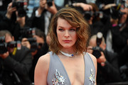 Milla Jovovich rocked teased waves at the Cannes Film Festival screening of 'Burning.'