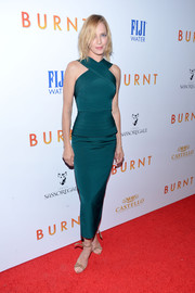Uma Thurman played up her slim, statuesque physique in a custom emerald crisscross-neckline dress by Brandon Maxwell at the New York premiere of 'Burnt.'