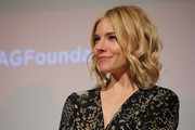Sienna Miller looked oh-so-cute with her perfectly styled curls at the SAG Foundation screening of 'Burnt.'