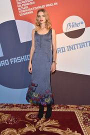 Natalia Vodianova attended the Buro 24/7 Fashion Forward Initiative wearing a textured blue corset dress with multicolored scallop detailing along the hem.