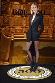 Anja Rubik looked fierce in a plunging black tuxedo romper by Saint Laurent at the #BoF500 cocktail event.