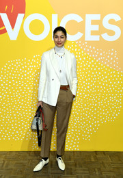 Caroline Issa teamed a white blazer with a turtleneck and khakis for day one of Voices 2019.
