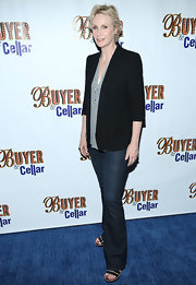 Jane Lynch stuck to a classic black blazer and jeans for her evening look.