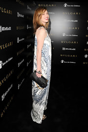 Milla Jovovich's ladylike black leather clutch was an unexpected choice for her free-spirited look.