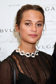 Alicia Vikander accessorized with a diamond collar necklace by Bulgari for a majorly glam finish.