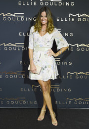 Kelly Bensimon was breezy in a boho print dress during Ellie Goulding's Art Basel performance.
