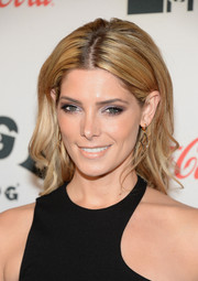 Ashley Greene styled her hair with sexy waves and a center part for the premiere of 'CBGB' in New York.