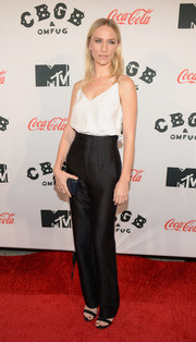 Mickey Sumner teamed high-waisted black slacks with a white camisole for a sophisticated finish at the 'CBGB' premiere in New York.