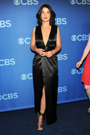 Cobie Smulders showed off her fit figure in this deep V-neck black gown.