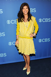 Julie Chen wasn't afraid of a little color when she opted for this sunny yellow tweed dress and matching cardigan.