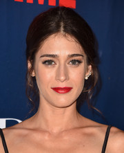 Lizzy Caplan opted for a conservative center-parted updo when she attended the CBS Summer TCA Party.