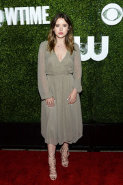 Taylor Spreitler opted for a simple, classic beige wrap dress when she attended the CBS Summer TCA Party.