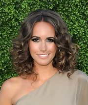 The beautiful Brit hit the red carpet sporting voluminous curls and smokey shadow.