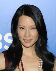 Lucy Liu arrived at the CBS Upfronts wearing her long hair in glossy layers.