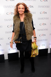 Diane von Furstenberg paired a fur vest over a little black dress for a dressed up but still casual look at the CFDA Awards Nominations.