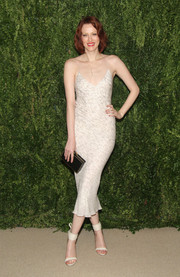 Karen Elson paired her sexy dress with white sandals featuring wide ankle straps.