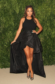 La La Anthony teamed lace Jimmy Choo pumps with her dress for an elegant finish.