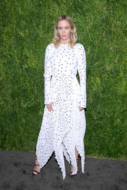 Emily Blunt kept it fun in a handkerchief-hem polka-dot dress by Khaite at the CFDA/Vogue Fashion Fund 15th anniversary event.