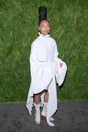 Logan Browning looked artsy in a loose white Pyer Moss blouse with oversized, pleated sleeves at the CFDA/Vogue Fashion Fund 15th anniversary event.