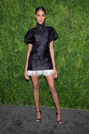 Cindy Bruna worked a leggy look in a J. Mendel LBD with a contrast feather hem at the CFDA/Vogue Fashion Fund 15th anniversary event.