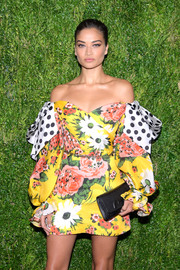 Shanina Shaik looked exuberant at the CFDA/Vogue Fashion Fund 15th anniversary event in a Carolina Herrera off-the-shoulder dress that featured a cute mix of florals and polka dots.