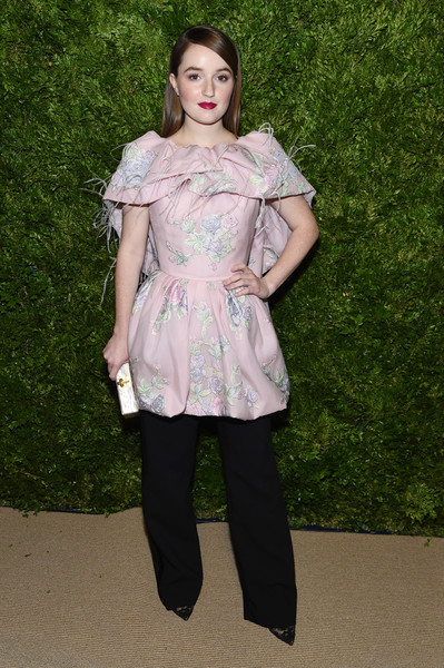 Kaitlyn Dever dolled up in a pink Prabal Gurung floral dress with feathered capelet detailing for the 2019 CFDA/Vogue Fashion Fund Awards.