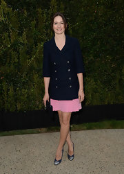 Emily Mortimer rocked a double-breasted navy blue blazer over her pink skirt.